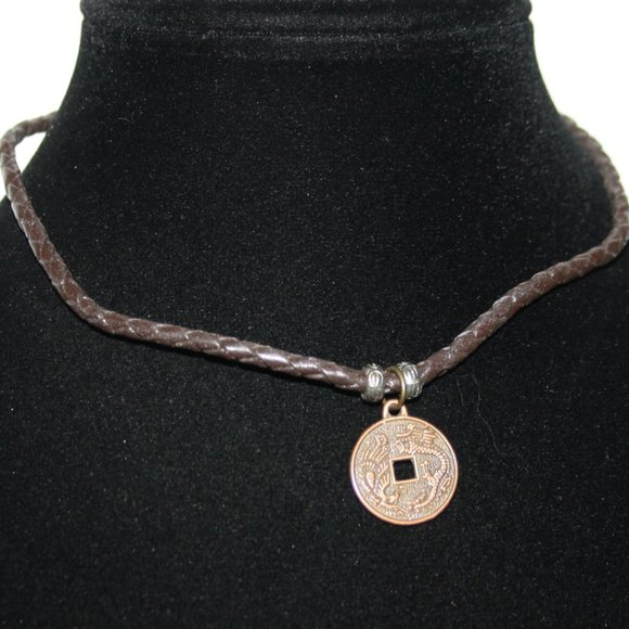 Brown leather necklace with silver and copper coin